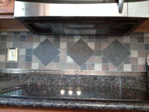 """With a hand set 6"""" x 6"""" accent tile"""