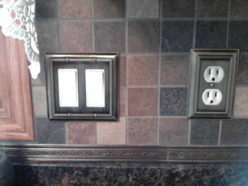 Coordinating metal border and switchplates