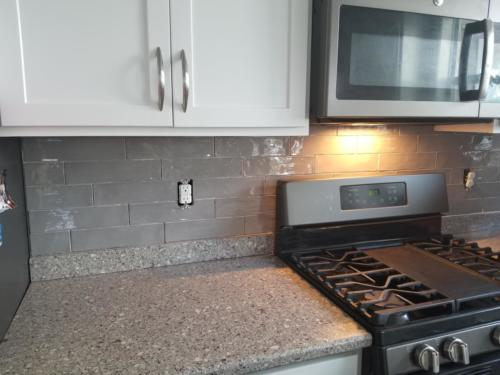 Grey high gloss subway tiles