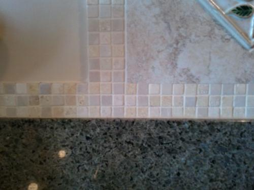 Finished with small mosaic accents.