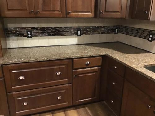 Schluter Dilex AHKA finishing metal cove installed at countertop base for easy cleaning!